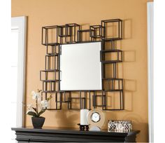Decorative Wall Mirror - Adorn your walls with this brilliant decorative wall mirror, perfect for hanging on an empty wall or above a console table. Geometric shapes surround the large mirror creating a dramatic abstract effect. Try hanging this mirror in your living room or home office for a brand new look that you are sure to love.