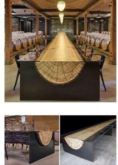 Bodega con larguísima mesa de un tronco, diseñada por John Houshmand.