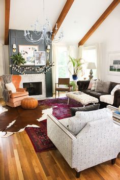 Rustic-Luxe Layered Rugs Nothing like an angled cowhide to add a little rustic appeal to a glamorous jewel-toned rug.