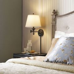 Conserve valuable bedside table space by installing a chic and convenient swing-arm wall lamp. Its warm glow is just what your bedroom sanctuary needs.