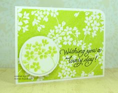 """By Karen Dunbrook. Uses negative stamp """"Glory of Modesty"""" by Penny Black. Stamp main panel with Memento Pear Tart. On separate piece of cardstock, stamp same stamp in VersaMark & heat emboss with white powder. Punch a circle from this piece. Color flowers with same ink & a water brush. Adhere on larger white circle & pop up on card. Add sentiment. Try this with any large negative stamp -- like Scallop Blossoms!"""
