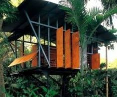 tropical house on stilts with large louvre sections