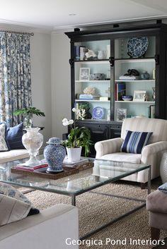 I think if we do black bookshelves we should lighten them up like this...Black bookshelves - with back painted Benjamin Moore Palladian Blue.
