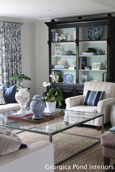 I think if we do black bookshelves we should lighten them up like this...Black bookshelves - with back painted Benjamin Moore Palladian Blue.