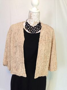 A personal favorite from my Etsy shop https://www.etsy.com/listing/254179750/1950s-champagne-rosette-dinner-jacket