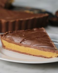 INGREDIENTS 4 cups milk chocolate chips, divided 2 cups creamy peanut butter 2 cups powdered sugar, sifted ½ cup butter, softened P. Candy Recipes, Sweet Recipes, Cookie Recipes, Dessert Recipes, Giant Peanut Butter Cup Recipe, Peanut Butter Recipes, Just Desserts, Delicious Desserts, Health Desserts