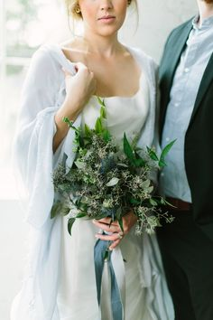 thistle and seeded eucalyptus bouquet, photo by Anne Brookshire http://ruffledblog.com/slate-gray-wedding-inspiration #weddingbouquet #flowers