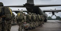 Soldiers of B Company of 2nd Battalion The Parachute Regiment line up to board a Royal Air Force Hercules at RAF Leeming, North Yorkshire.