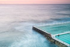 Lone Icebergs Swimmer – Seb Ruiz Photography