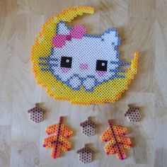 Fall Hello Kitty in moon perler beads by AuntieBoosCrafties