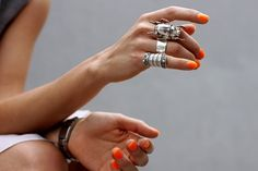 silver rings and orange polish. love the silver beetle ring.