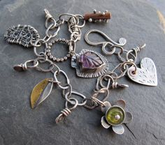 Hey, I found this really awesome Etsy listing at https://www.etsy.com/dk-en/listing/173903521/silver-charm-bracelet-wire-wrapped