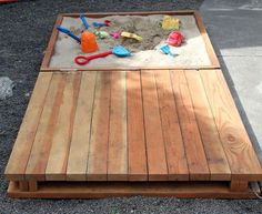"Lid/Deck to a sandbox, with the handle the correct height to act as ""feet"" when it is open - so you can sit on the deck and watch your tyke in the sand.  Close it up when you are done.  How simple and modern.  From Smallfriendly.com"