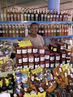 Woman Selling Locally Produced Food at the Market in Sainte Anne, Lesser Antilles. Photo: Yahid Levy