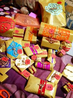Birthday Gift DIY - 27 Presents wrapped in brown paper with coloured pattern, tied with a brown twine for the 27th Birthday! Make sure you tag each gifts and write a short description for each one. Trust me, it's a very fun gift idea to do!