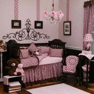 Beautiful nursery with pink and brown. Lots of polka dots.