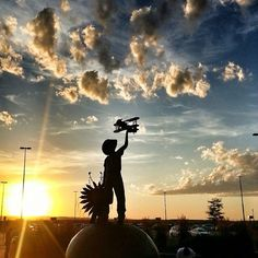 """Stunning sunset photo of the """"Siouxper Boy"""" sculpture at the Rapid City Regional Airport. Its message is to dream big and believe anything is possible. Come and #DoBigThings in Rapid City! 