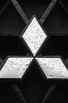 This is a good example of SHAPE because, its 3 diamonds making up the Mitsubishi emblem. The logo itself is positive, and the dark background is negative but still has positive in it.