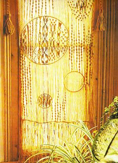 a carefully constructed macrame window hanger. You can just feel the love and warmth that has gone into this wonderful creation.