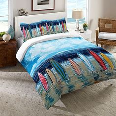 The Laural Home Surfboards Comforter brings the endless summer into your bedroom. Featuring a gorgeous beach scene with colorful surfboards standing in the sand, the bright and fun bedding is the perfect way to enliven your bedroom's décor.