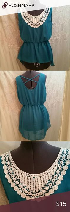 NWOT BEAUTIFUL HI LOW TOP This beautiful top is a teal color beautiful ivory crochet lace . Material is sheer . It runs small. Tops Blouses