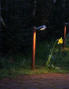 Moonlight Design used a Hunza border light in copper fitted with a warm white LED to highlight this path.