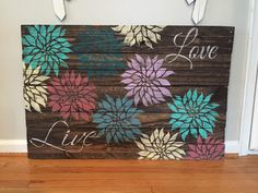 Pallet wood flower art - A personal favorite from my Etsy shop https://www.etsy.com/listing/264252312/large-stained-colorful-flower-live-love
