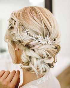 Pretty updo hairstyle with hair accessories #updohairstyles #weddingupdo #bridehair #updo