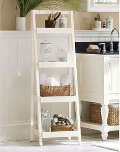 Look at the beadboard wainscoting and molding behind the counter Bath Ladder Storage, White traditional-medicine-cabinets