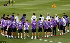 Real Madrid's squad observe a minutes' silence for those who lost their lives in the crash
