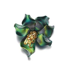 Topaz and diamond brooch, Margherita Burgener  Designed as a stylised flower accented with pear-shaped topaz and brilliant-cut diamonds
