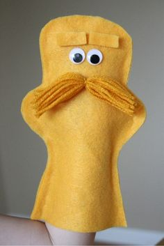 The lorax hand puppet! Maybe make it into a sewing activity? Hole punch along the edges and then hot glue the moustache, eyes and eyebrows on...