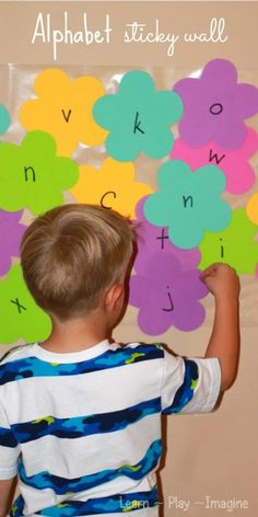 Create an alphabet sticky wall to work on letter recognition and letter sounds - preschool activity for spring
