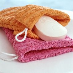 stitch the edges of two washclothes to make a soap storage scrubby. way more sanitary than a loofah as they are machine washable so they won't collect so much bacteria. clever~~