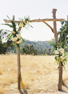 Romantic driftwood arbor more for a mountain theme than a beach theme.