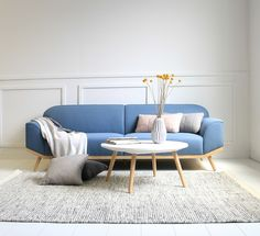 The iconic Otto 3 seater by Sketch Interior (don't you LOVE its pigeon blue colour!) with the Stork coffee table, the Asko mixed rug by Linie Design Rugs (100% wool)