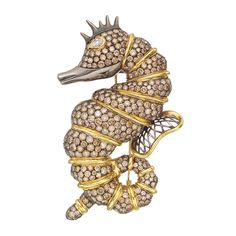 Estate Betteridge Collection Large Brown Diamond Seahorse Brooch set with circular-cut brown diamonds weighing approximately 16.53 total carats separated by 18k yellow gold bands, with a pear-shaped white diamond eye weighing approximately 0.50 carats and 18k gold openwork wing, mounted in blackened 18k white gold.