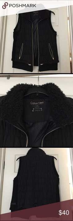 Calvin Klein performance puffy vest Cute comfortable black Calvin Klein vest. Soft fluffy collar, full zip pockets and toggle bottom close. Great condition only worn twice. Calvin Klein Jackets & Coats Vests