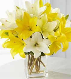 The Summer Essentials Lily Bouquet is a burst of sunshine required for the perfect day! Yellow and white Asiatic Lilies serenely sit in a clear glass vase to create a lovely expression of endless fun and vivacious energy. Diy Wedding Bouquet, Wedding Flowers, Prom Flowers, Spring Flowers, White Lily Bouquet, White Lilies, Lily Centerpieces, Centrepieces, Wedding Centerpieces