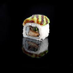 Dragon / eel with cucumber inside and avocado, tobiko & sauce eel outside