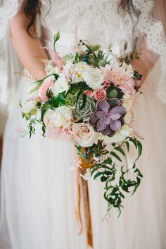 Cascading bridal bouquet by designer Courtenay Lambert of Courtenay Lambert Florals - Cincinnati, Ohio, with succulents, café au lait dahlia...