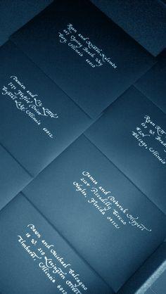 White lettering on black envelopes - #wedding #calligraphy