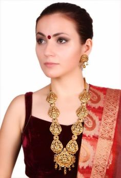 Kamla Laxmiji virajit necklace set Necklace with earring Dimension: L: 14 inches, earring: 2 inches Weight: 130 gm  Color: Golden, blue Material: Gold plated  Closure: Metallic lock Finish: Hand crafted Inspiration: South-Indian temple jewelry