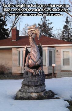 Awesome dragon sculpture carved from a tree stump.