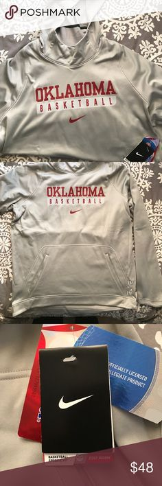 NIKE HOODIE NIKE Brand New With Tags. Oklahoma Basketball Men's size L. Basketball specific fit, stay warm, therma fit. Pewter color. Nike Shirts Sweatshirts & Hoodies