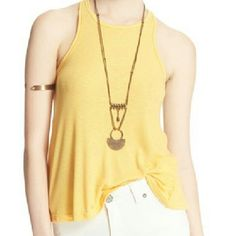 Free People swing tank NWT NWT SZ S. (MY ONLY LARGE HAS SOLD). Color is buttercup. Ribbed, loose fitting swingy tank . Free People Tops Tank Tops