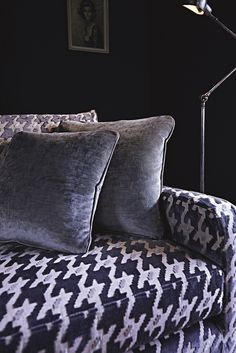 Pair a vibrant print and a comfy armchair to create a beautiful accent armchair. Featured here is Multiyork's Dexter Snuggler in Camden Grey velvet.