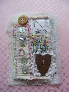 buttons and birds embroidered vintage mixed media textile brooch