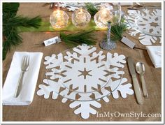 Table-snowflake-placemats out of white fabric - check out the glitter wine glass and the clear plate