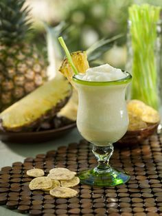 Pina Colada: 1 1/2 c. Ice; 1/2 c. diced pineapple, frozen; 2 oz pineapple juice; 2 oz Coco Lopez coconut cream; 1 1/2 oz white rum; 1 oz dark rum; pineapple slices for garnish. Blend everything but the garnish.  Garnish rim of glass. Apply as needed.